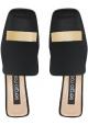 Tanga de mujer Sergio Rossi, zapatillas de cuero negras.